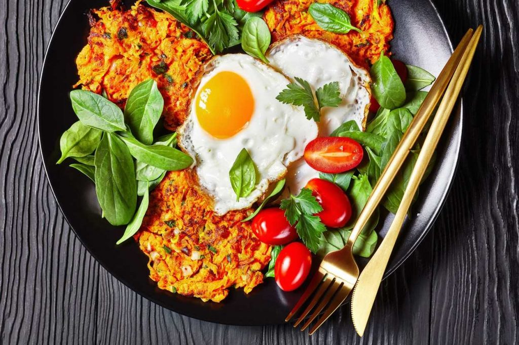 Eggs with carrot pancakes
