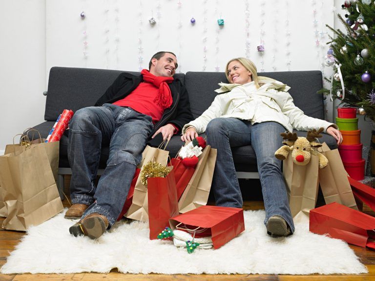 Couple exhausted after christmas shopping