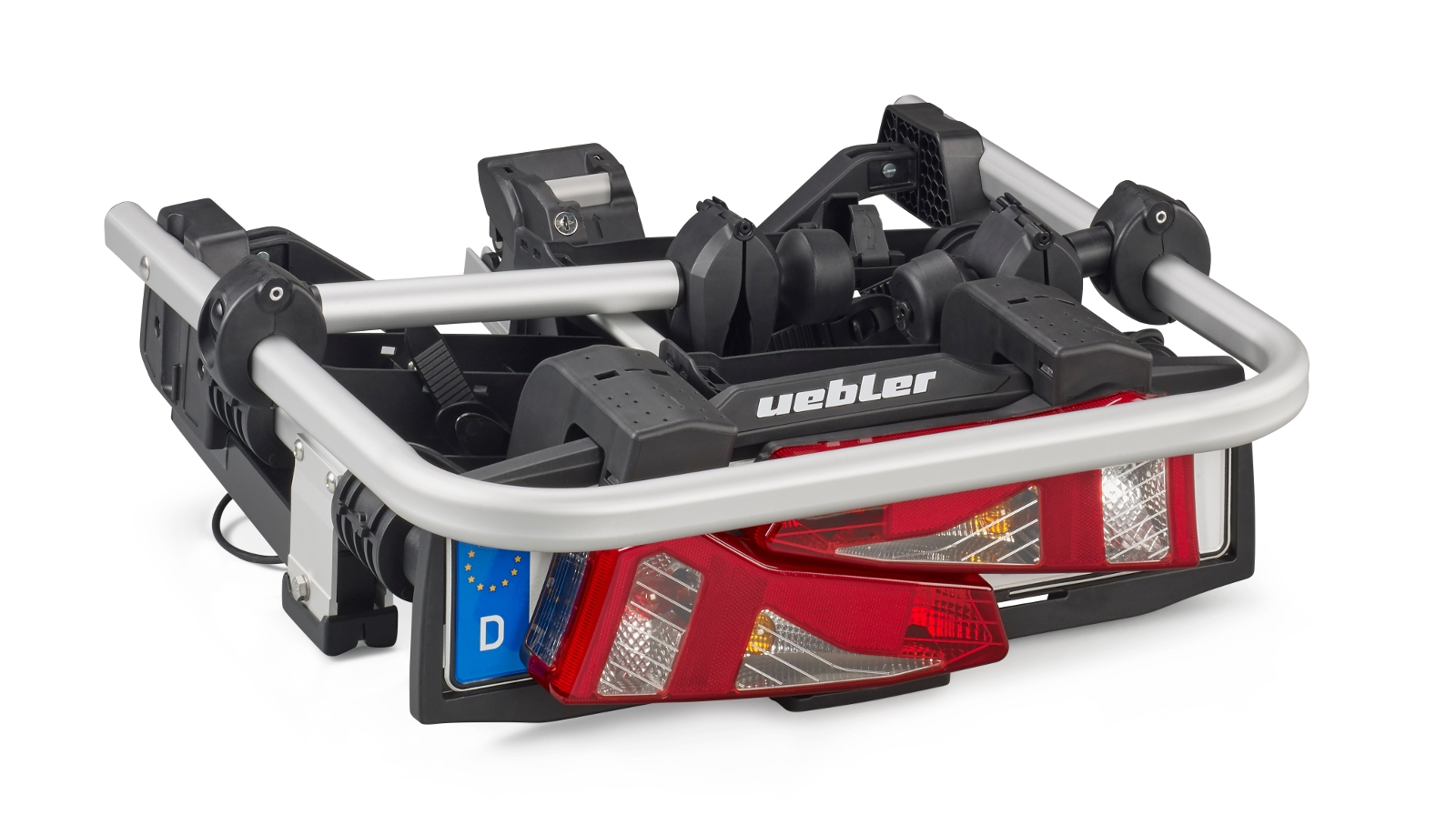 Nosič jízdního kola na tažné zařízení ve složené podobě, kterou lze snadno uskladnit do kufru.