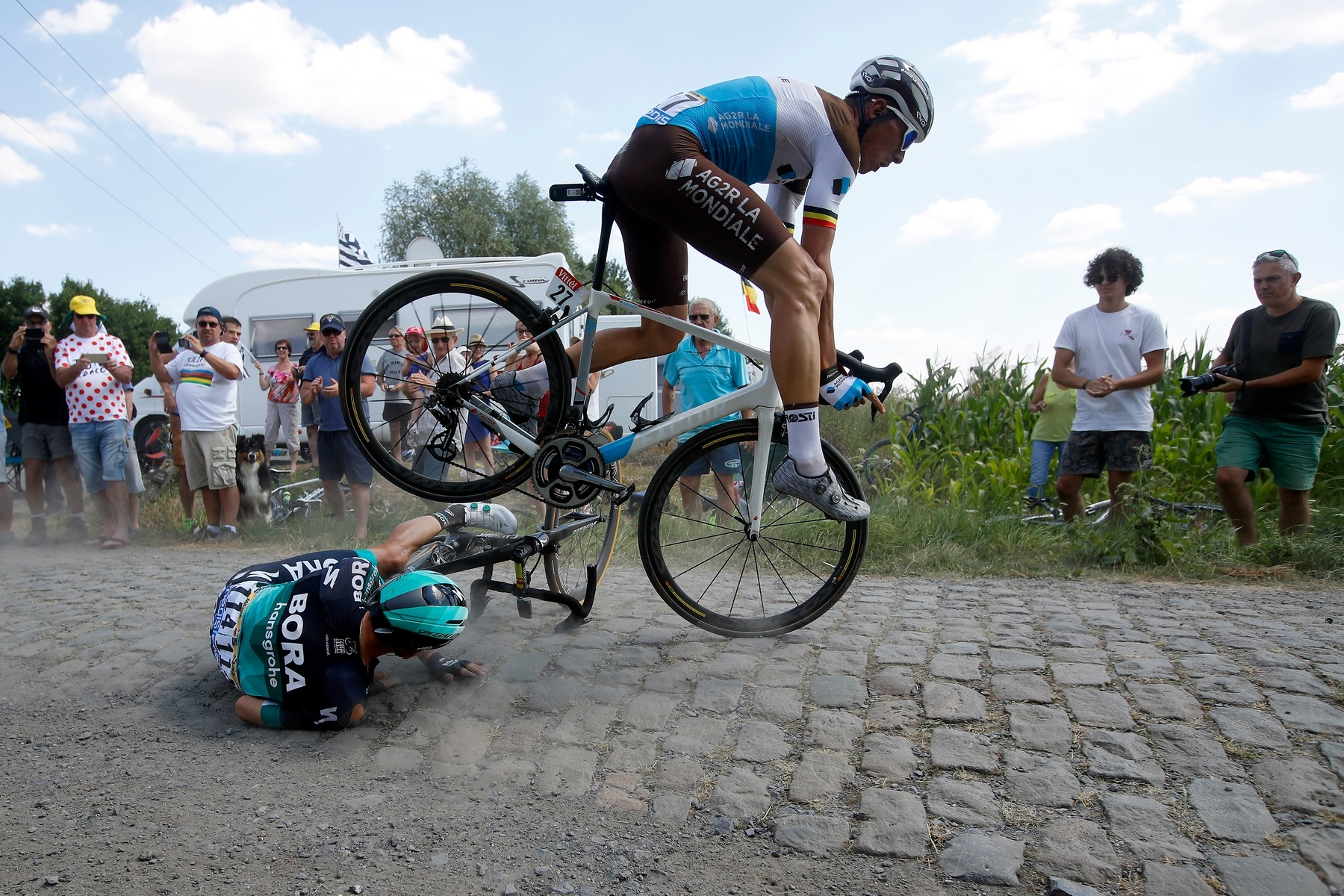 Bora Hansgrohe team rider Rafal Majka (down) of Poland and AG2R La Mondiale team rider Olivier Naesen (R) of Belgium crash during the 9th stage of the 105th edition of the Tour de France cycling race over 156,5km between Arras and Roubaix, France, 15 July 2018