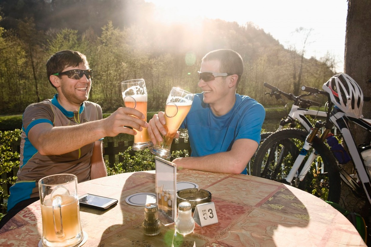 Young men drinking beer, Bavaria, Germany