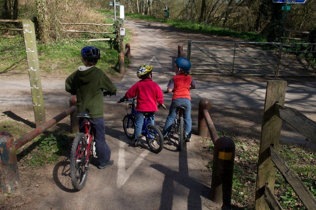 The best way to encourage and support children as they learn to cycle is to do it with them.  It's a wonderful bonding experience, and as they improve you will be able to head off on the most wonderful adventures.