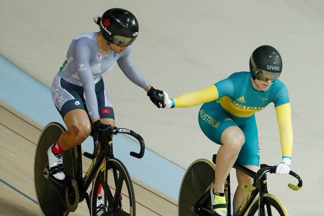 Hong Kong's Lee Wai Sze (L) shakes hands with Australia's Anna Meares after coming in ahead of her in the Women's sprint last 8 track cycling event at the Velodrome during the Rio 2016 Olympic Games.