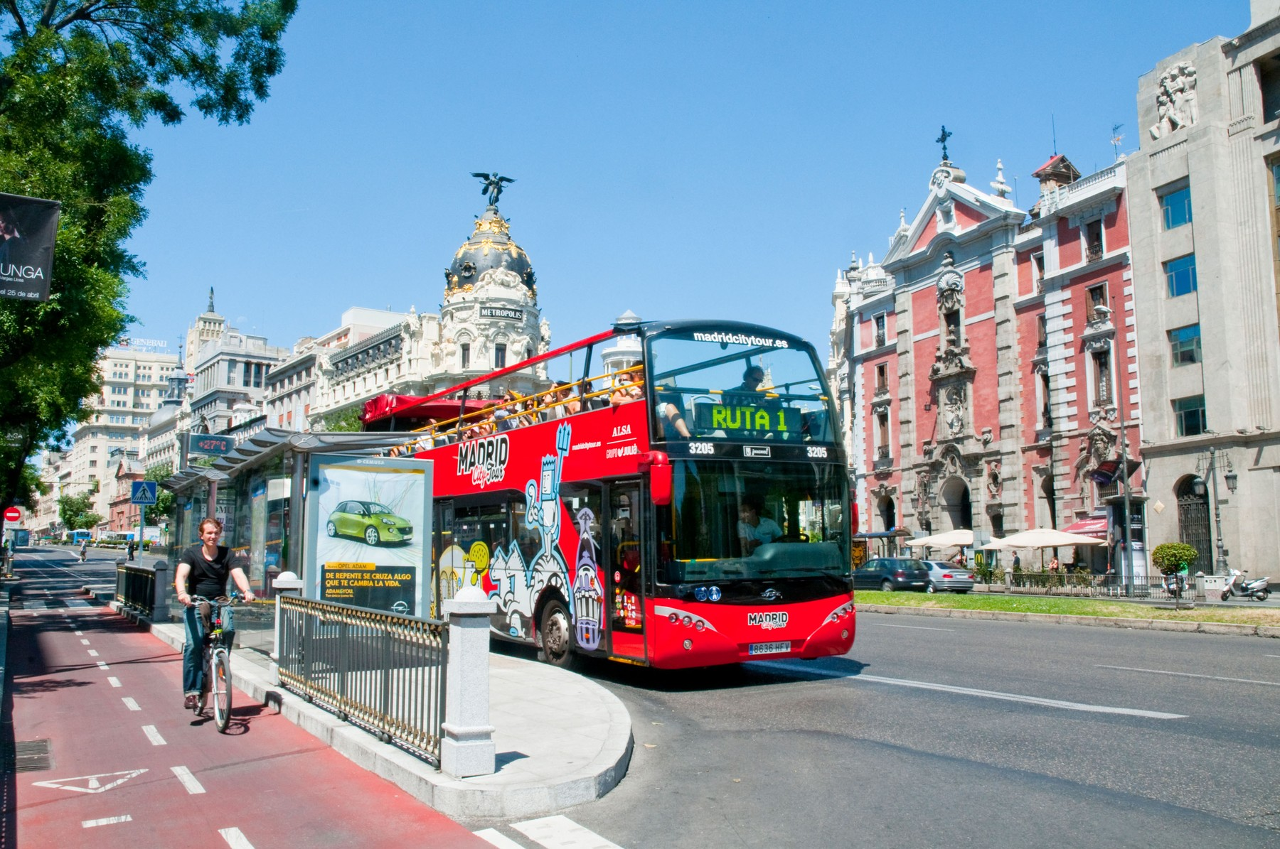Tourist bus and cycle lane in Alcala street. Madrid, Spain.
