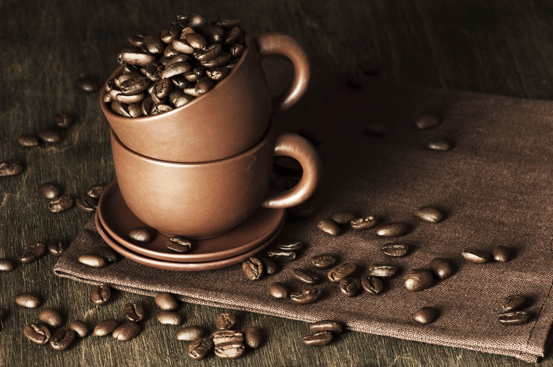 Roasted coffee beans in ceramic cups on vintage wooden background., Image: 185807335, License: Royalty-free, Restrictions: , Model Release: no, Credit line: Profimedia, Stock Budget