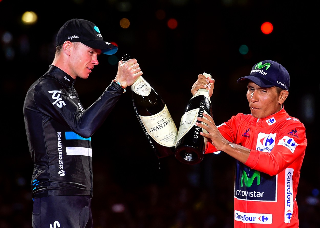 """Winner of La Vuelta 2016, Movistar's Colombian cyclist Nairo Quintana (R) and second placed Sky's British cyclist Christopher Froome toast on the podium of the last stage of the 71st edition of """"La Vuelta"""" Tour of Spain, a 104.8km route Las Rozas to Madrid, on September 11, 2016., Image: 299535188, License: Rights-managed, Restrictions: , Model Release: no, Credit line: Profimedia, AFP"""