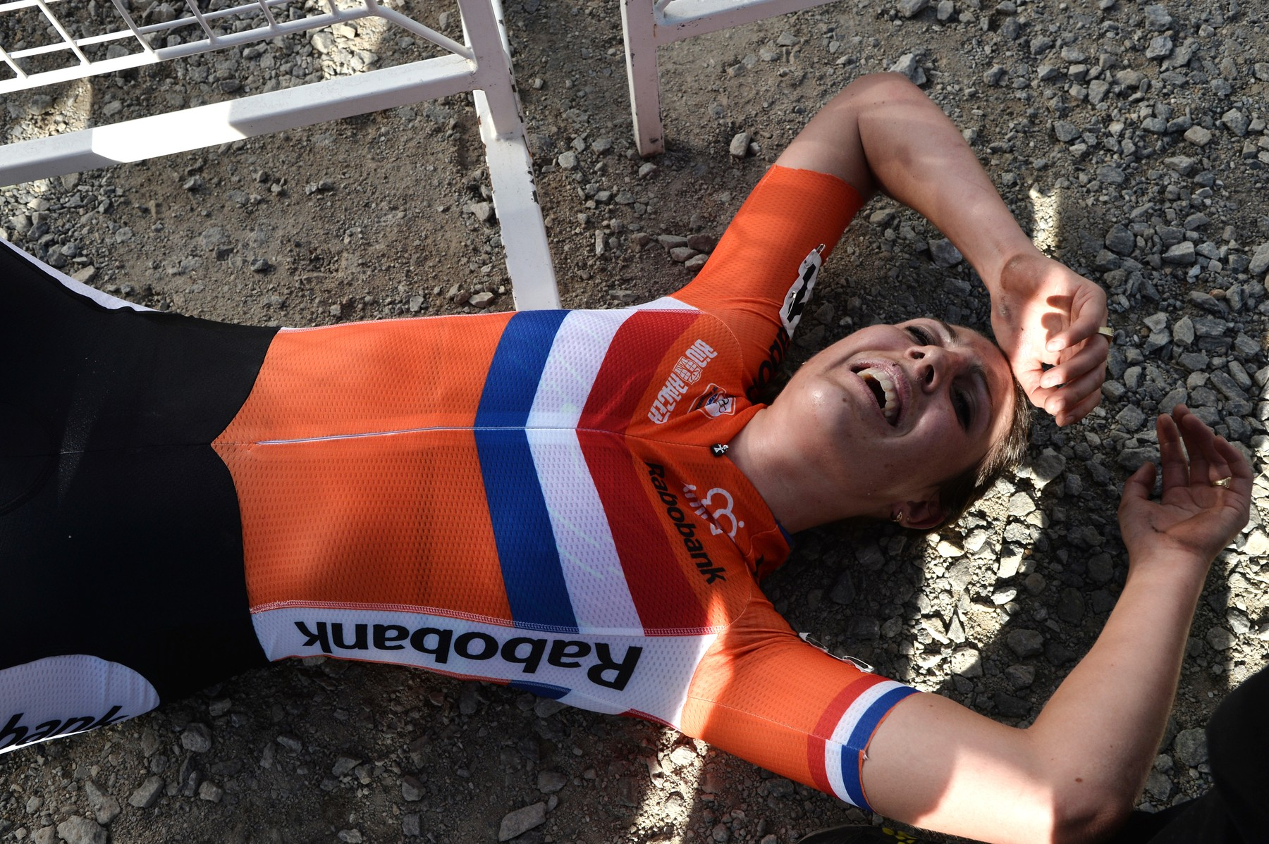 Dutch cyclist Lucinda Brand lies on the ground after finishing the Women Elite European Cyclocross Championships at the second place, on October 30, 2016, in Pontchateau, France.
