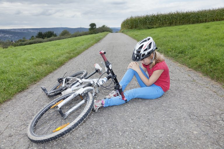 It is very important to get out of the road or to the edge of the trail to avoid a crash with a car or another rider. If you are on a road and can't walk, pull yourself to the side somehow. Cars don't notice cyclists when we're upright; so don't expect them to see you when you're on the ground.